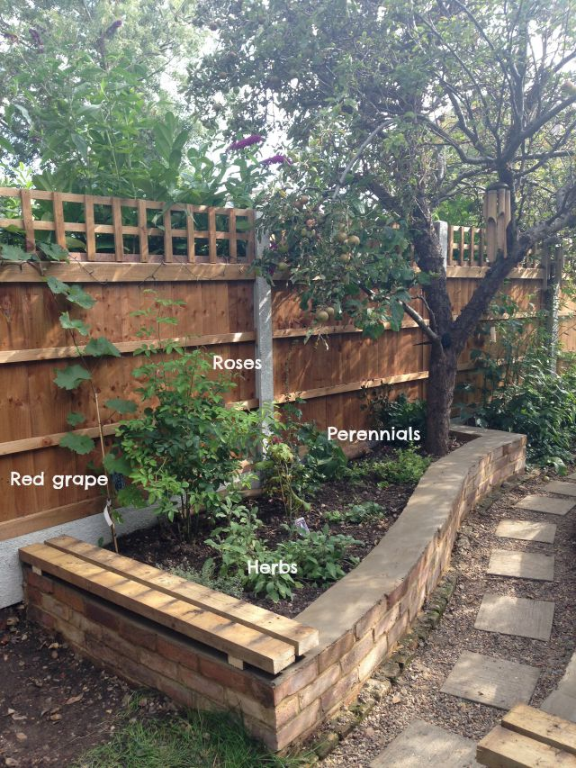 Raised bed, flowers, grape, herbs, reclaimed brick, secretgardenhome